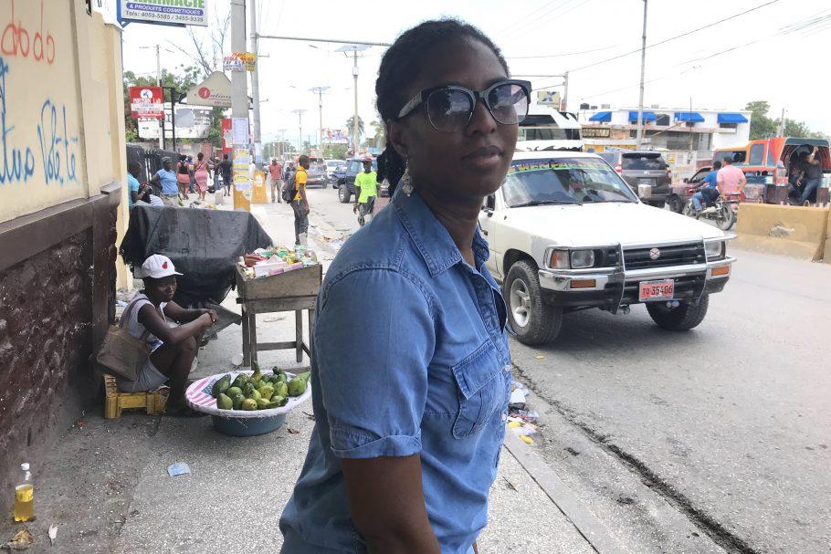 Marli waits on taptap in Haiti
