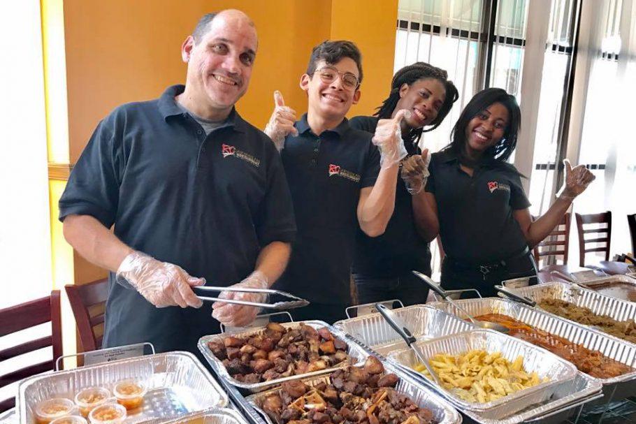 RC Caribbean Restaurant Stands with Haiti